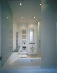 White and glass make this bath appear bigger.