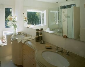 The Art Deco-style vanity provides a distinctive focal point in this bathroom.