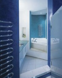 This cool blue bathroom is made for relaxation.