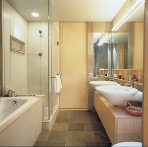 In a tight bathroom, streamlining the space gives the impression of more room.