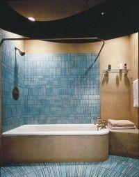 Aqua tiles on walls and floor provide a focal point.