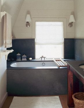 A modern, minimalist aesthetic mixed with rustic materials gives this transitional bathroom design a unique feeling.