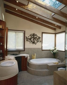 The straight beams of the ceiling provide a nice contrast with the curved lines in the fixtures.