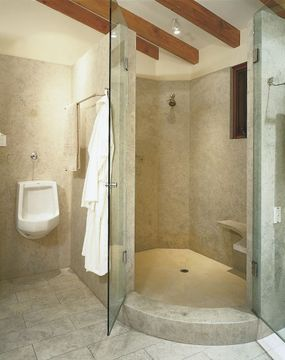 The rounded shower stall is simple, yet elegantly luxurious.