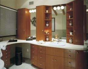 The Art-Deco-style vanity provides pleasing lines and plenty of storage in this transitional bathroom design.