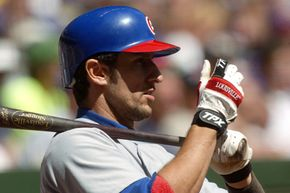 Nomar Garciaparra was famous -- perhaps infamous -- for adjusting his gloves as part of his batting ritual. See more sports pictures.