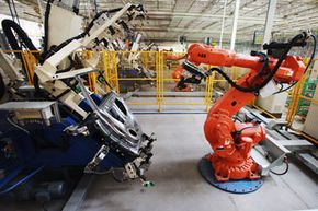 Baxter is not able to do the heavy-duty work that robots like these do in an automotive plant in Tianjin, China, but it's much easier and more affordable for smaller companies to integrate Baxter into their workplaces.