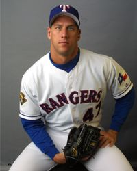 John Rocker, playing for the Texas Rangers at the time, poses for a photo in 2002.