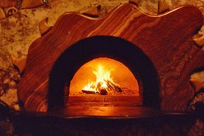 A pizza oven is both a great accent to an outdoor living area as well as a way to make tasty breads and pizzas. See how to build your own bbq pit with this step-by-step guide to building a barbecue pit.