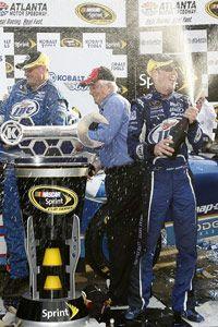 Driver Kurt Busch celebrates after winning the NASCAR Kobalt Tools 500 race at the Atlanta Motor Speedway in March 2009.