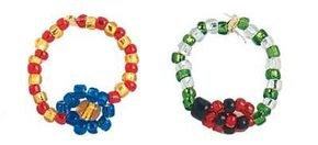 Use the technique from the daisy ring (left) to make a ladybug pattern (right) beaded ring.