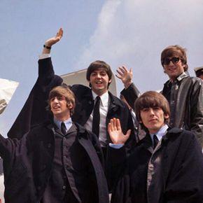 The Beatles arrive in London on July 2, 1964, following an Australian tour.