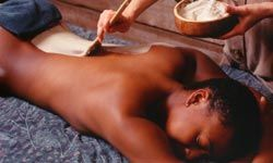 A body wrap begins by exfoliating the skin with a scrub, followed by a body mask (shown here), and then a cloth wrap.