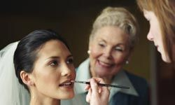 Having your bridal makeup professionally done ensures you'll be camera-ready for hours.