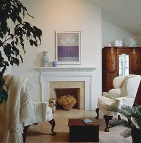 Comfortable wing chairs in the sitting area add to the room's cozy feel.