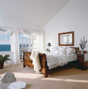 ©Janet Brown Interiors, Eric Roth Photography                              White linens and an inviting bed transform this room into a sanctuary.