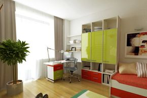 A desk, tall shelves and cubbies give an organized crafter room to work.