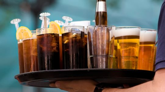 Why does beer form a head but soda doesn't?