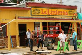 Many states offer filmmakers incentives for bringing business to their local economies, like breaks on below-the-line expenses. Here, a crew has turned a pizza restaurant in Massachusetts into a Cuban cafe.