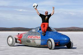 John Lynch of Victoria celebrates after recording a speed of 301.729 miles per hour while driving his Belly Tank Lakester during the Dry Lakes Racers of Australia Speed Week (2005) in Lake Gairdner, South Australia.