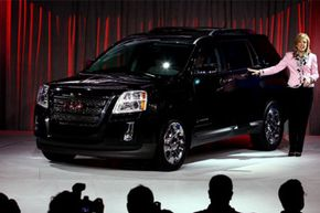 General Motors North America Vice President Susan Docherty unveils the 2010 GMC Terrain at the 2009 New York Auto Show at the Jacob Javits Convention Center in New York, New York.