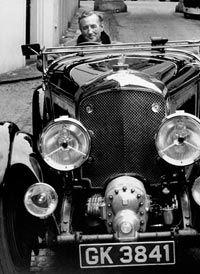 """James Bond"" creator Ian Fleming sits behind the wheel of a Bentley, Bond's original vehicle of choice."
