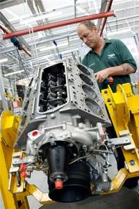 A Crewe employee puts the finishing touches on a Bentley motor.
