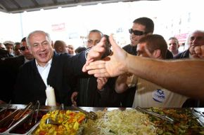 Israeli Prime Minister Benjamin Netanyahu burnished his 'everyman' appeal with a stop at a falafel stand in Israel during a campaign tour in 2009. We rate falafel as one of the world's best street foods. See more pictures of fast food.