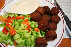 A plate of falafel accompanied by some salad and hummus makes a great meal.