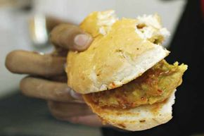 A detailed view of the popular food snack vada pav from a Jumbo King fast-food outlet in Mumbai.