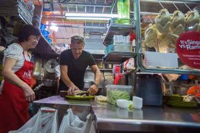 British chef Gordon Ramsay visits owner Foo Kui Lian of the Tian Tian chicken rice stall at the Maxwell Food Centre in Singapore to learn about the dish in 2013.