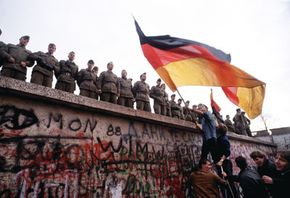 Nov. 10, 1989: East German border guards try to prevent a crowd climbing onto the Berlin Wall on the morning that the first section was pulled down.