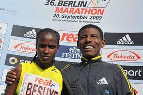 Ethiopians Haile Gebrselassie (right) and Atsede Habtamu Besuye (left) pose after winning the 36th Berlin Marathon in Berlin, Germany, Sunday, Sept. 20, 2009.