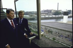 President Ronald W. Reagan, left, viewing the Berlin Wall from the balcony of the Reichstag.