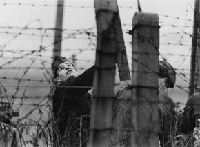 A border patrol on the Berlin Wall