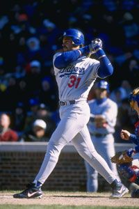 Los Angeles Dodger's catcher Mike Piazza, shown here in a 1996 game against the Chicago Cubs, was one of baseball's biggest bargains.