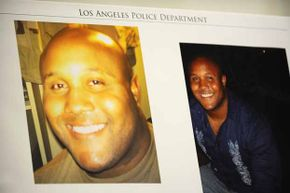 Photos of fired Los Angeles Police Department officer Christopher Dorner are seen at a press conference regarding the manhunt for him.