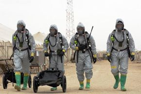 U.S. Marines with the 15th Marine Expeditionary Unit (Special Operations Capable) head back to their decontamination area after completing an enhanced nuclear, biological and chemical defense exercise at Camp Buehring, Kuwait, in Feb. 2005.