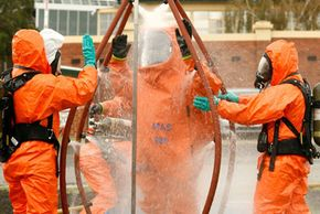 Emergency crews are decontaminated as police in the Australian state of Victoria conduct a chemical, biological, radiological (CBR) hostage exercise at Caulfield Racecourse in Melbourne, Australia.