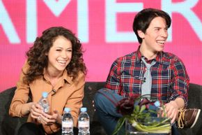 Tatiana Maslany and Jordan Gavaris, stars of the show, laugh at a panel discussion.