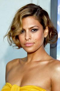 Moles sometimes accentuate beauty. Actress Eva Mendes has a prominent mole on her left cheek.