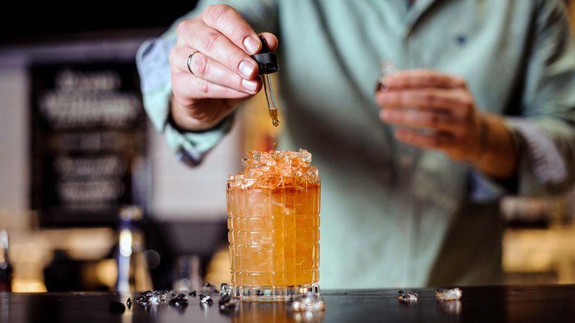 bartender using bitters