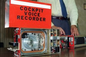An old-school cockpit voice recorder and flight data recorder (right) on display from United Airlines flight 232, which crashed in 1989.