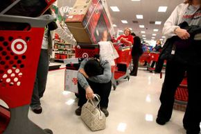 Trinh Pham, 22, of Arlington, appears exhausted as she waits in line at a Target in Allen, Texas on Thanksgiving night, 2010.