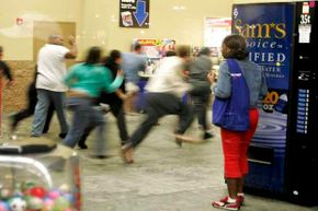Shoppers sprint through the doors of a Miami Wal-Mart as it opens at 5 a.m. on Black Friday in 2005.