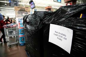 Black Friday specials shrinkwrapped in plastic like these were ripped open early by some sharky consumers in Upland, N.Y.