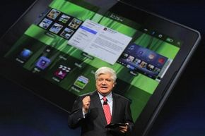 Mike Lazaridis, president and co-chief executive officer of BlackBerry parent company Research in Motion, announces the BlackBerry PlayBook at BlackBerryDevCon 2010 on Sept. 27, 2010. See more gadget pictures.