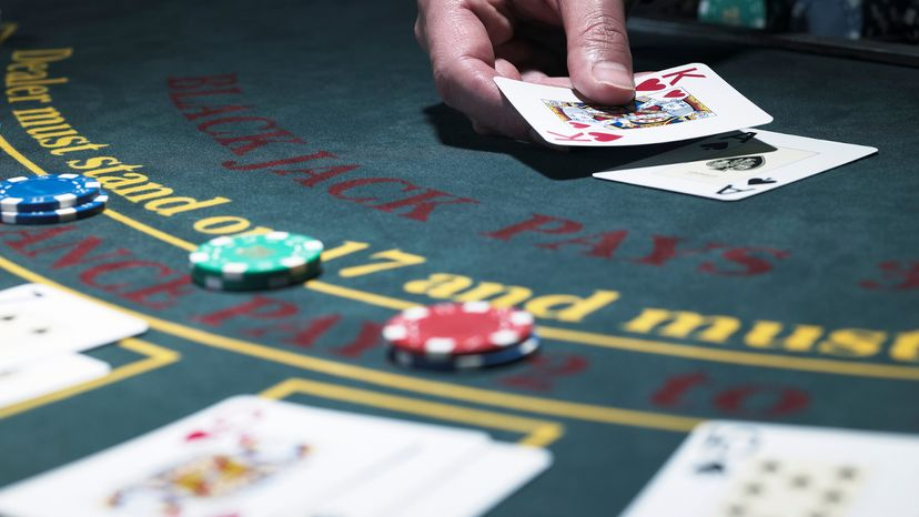 Dealer Playing Blackjack at a Casino Table
