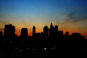 The sun sets over the Manhattan skyline Aug. 14, 2003, during a major power outage.