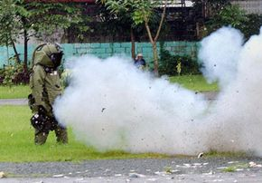 A police bomb disposal expert wearing a blast-resistant bomb suit is unscathed after a test explosion at the police camp in Manila, Philippines, in October 2003.
